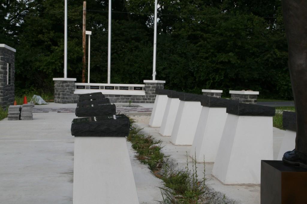memorial stones mounted on pedestals